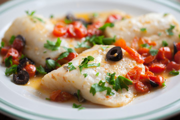 Fish fillet with cherry tomatoes and olives