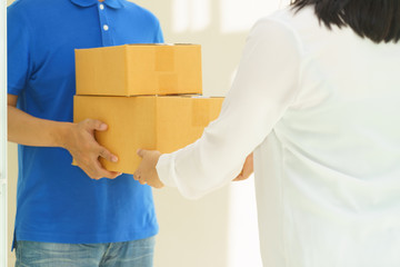Woman receiving package from delivery man.