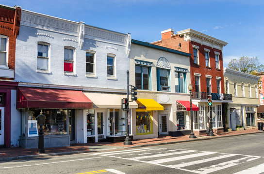 Traditional Old American Buildings with Colourful Shops along a Brick Sidewalk on a Clear Autumn Day