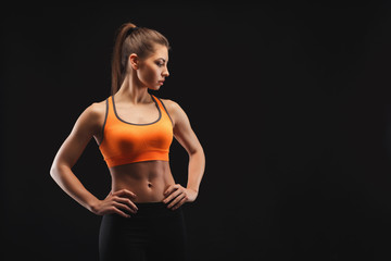 Athletic woman on black background