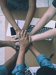 business working team put hand together for fighting; working team building