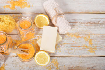 Refreshing lemon salt for feet and bath with oil and honey  moisturizing the body with natural soap and a sponge with free space for text