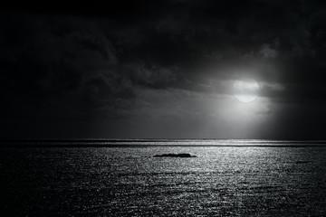 Glistening sea in a full moon night