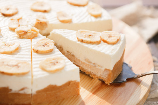 Delicious banana cake on table