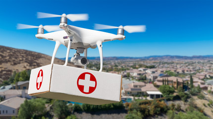 Unmanned Aircraft System (UAS) Quadcopter Drone Carrying First Aid Package Over Neighborhood.