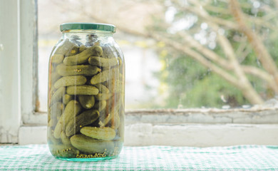Homemade tasty tasty pickles in a glass jar