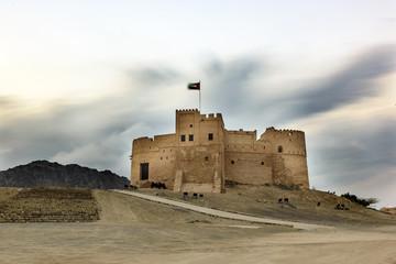 Foto auf Leinwand Befestigung Spectacular View of Fujairah Fort in United Arab Emirates at Night