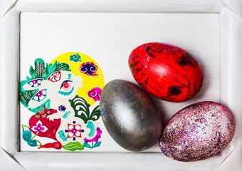 Painted Easter eggs in a picture frame