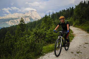 Mountain biking woman in Dolomites, Italy