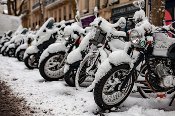 Snow covered motorbikes in Paris