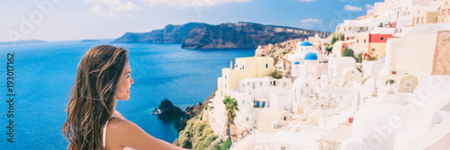 Wall mural Travel luxury Europe vacation woman banner. Tourist Asian lady Greece Santorini holiday person looking at view of famous travel destination.