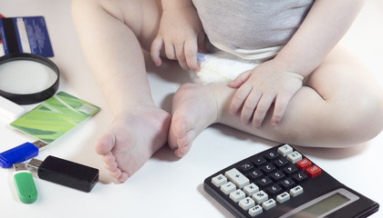 Baby legs and pens, calculator, credit cards, flash drives