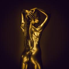 Golden lady on dark background