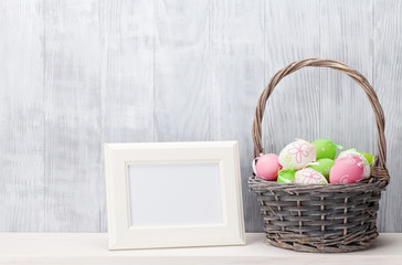 Easter eggs and blank photo frame