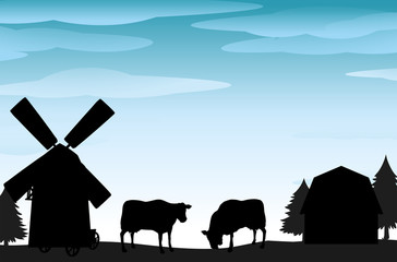 Silhouette scene with cows and barns