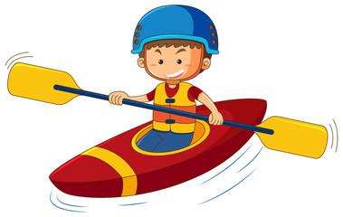 Boy wearing lifejacket and helmet in canoe