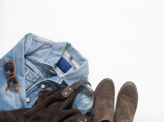 Spring, autumn female outfit. Set of clothes, shoes and accessories on white background. Blue denim jacket, brown bag and shoes.