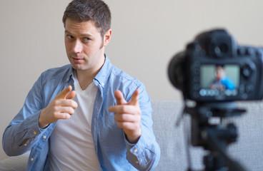 Handsome man making video blog. Concept of blogging.