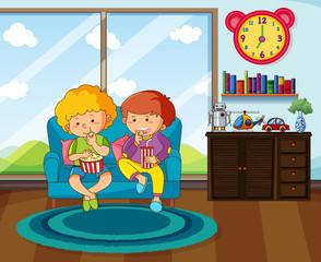 Two boys eating snack in livingroom