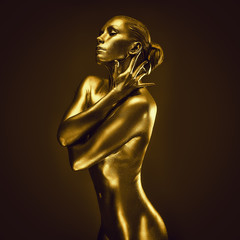 Golden lady on dark background