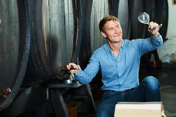 Man sommelier in wine cellar