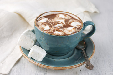 Hot chocolate with whipped cream and marshmallow