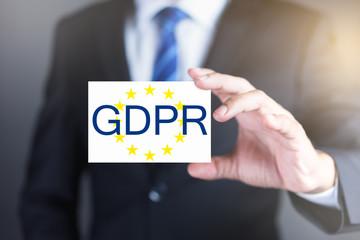 Businessman holding General Data Protection Regulation card. GDPR Concept.