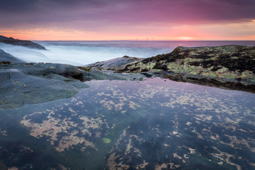 Sunrise at coastline nearby Pemaquid Point lighthouse, Maine, USA