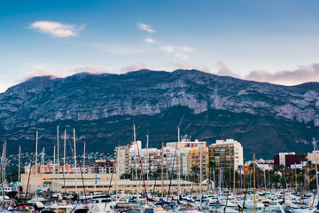 Foto op Plexiglas Stad aan het water Denia port with castle and mountain montgo hill and yacht in alicante province Spain