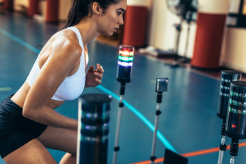 Woman doing reaction time training session at gym