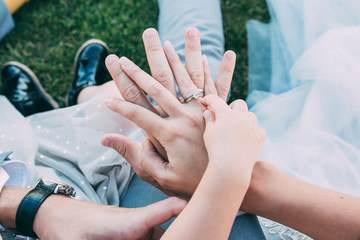 Mom's, daddy's and daughter's hands