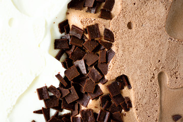 Scooped vanilla and chocolate ice cream background. Summer food concept, copy space, top view. Sweet yogurt dessert or brown ice-cream texture.