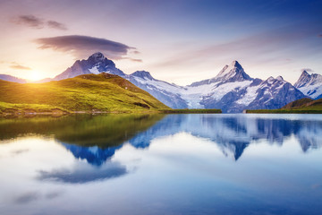 Alpine view of the Mt. Schreckhorn and Wetterhorn. Location Bachalpsee in Swiss alps, Grindelwald valley, Europe.