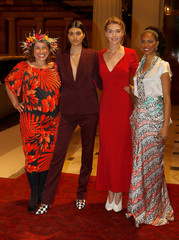 Artisan fashion designer Marama Papau poses for a photograph with models Neelam Gill, Arizona Muse and Noella Coursaris in London
