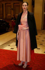 Model O'Conner poses for a photograph as she arrives at the Commonwealth Fashion Exchange Reception at Buckingham Palace in London