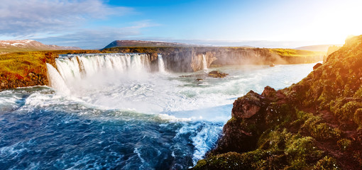 Nice views of the bright sunlit powerful Godafoss cascade. Location Skjalfandafljot river, Iceland, Europe. Beauty world.