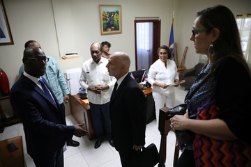 Oxfam's Ticehurst and Massot speak with Haiti's Minister of Planning and External Cooperation Aviol Fleurant in Port-au-Prince