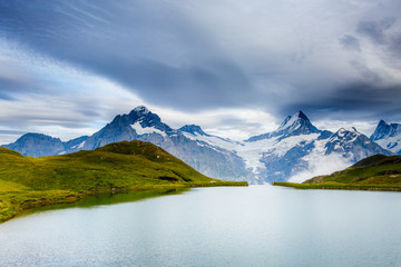 Great view of Mt. Schreckhorn and Wetterhorn above Bachalpsee lake. Location Swiss alp, Bernese Oberland, Grindelwald, Europe.