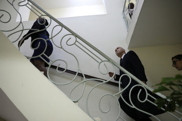 Oxfam's Ticehurst walks upstairs at his arrival to the Ministry of Planning and External Cooperation for a meeting with Minister Fleurant in Port-au-Prince