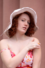 nice red-haired woman with pale skin