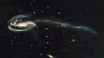 The Tadpole Galaxy, spiral galaxy in constellation Draco. Elements of this image furnished by NASA. Retouched image.