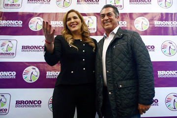 Independent presidential pre-candidate Jaime Rodriguez, also known as Bronco, poses for a photo with his wife Adalina Davalos after a news conference in Mexico City