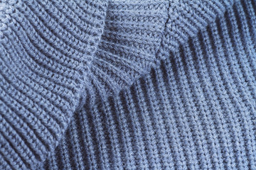 Sweater fabric texture. Part of knitted wool.