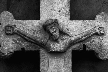 Partially destroyed ancient statue of the crucifixion of Jesus Christ (Faith, religion, suffering, love, God concept)