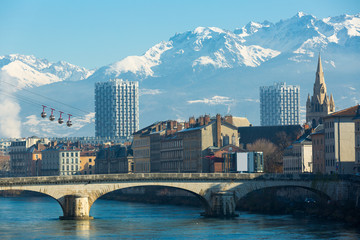 Fotobehang Stad aan het water Aerial view of Grenoble cable car with French Alps and bridge