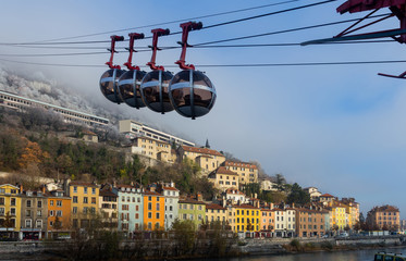 View of French Alps and Grenoble cable car in autumn