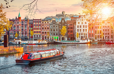 Fototapete - Channel in Amsterdam Netherlands houses river Amstel landmark