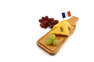 Cheese chopping board stock images. Cheese isolated on a white background. French cheese with grapes. Healthy snack images