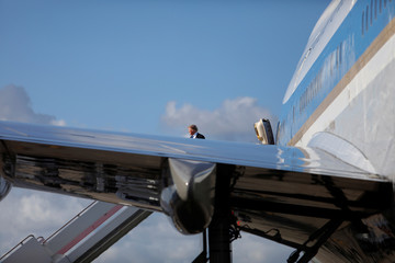 U.S. President Donald Trump boards Air Force One as he departs for Joint Base Andrews, Maryland from West Palm Beach