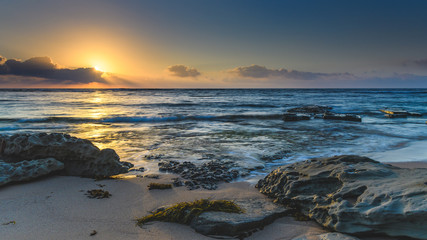 Sunrise Seascape with Rocks